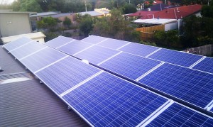 Poly solar PV panels placed in horizontal landscape orientation on a flat roof